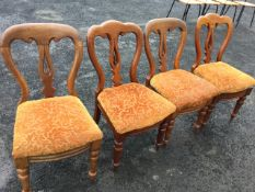 A married set of four Victorian mahogany dining chairs, the scroll carved backs above pierced