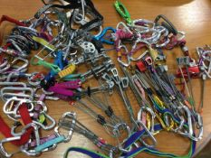 A quantity of modern climbing gear - friends, karabiners, nuts, slings, belay devices, screwgates, a
