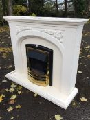 A contemporary painted chimneypiece, the mantelpiece with dentil cornice above vine moulded