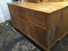 An oak arts & crafts style dresser, with rectangular top above a bank of four central drawers framed