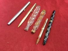 A gold pencil case - rubbed marks; a rolled gold Parker 61/65 propelling pencil; a Sheaffers