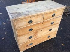 A Victorian pine chest of drawers, the rectangular moulded top above two short and three long