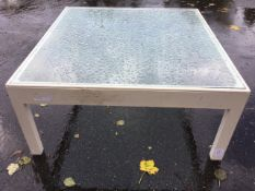A large painted coffee table with plate glass top on square chamfered column legs. (37in x 35in x