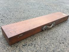 A Victorian mahogany gun case of dovetailed construction, having leather handle and brass hinges &