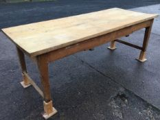 A Victorian kitchen table, the rectangular two plank chestnut top on dowel jointed pine base with