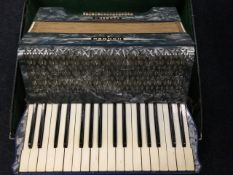 A cased Horner accordion, model Carmen II with marbled squeezebox and two octave keyboard, mounted