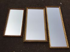 Three rectangular mirrors with foliate moulded gilt frames, one with bevelled plate. (3)