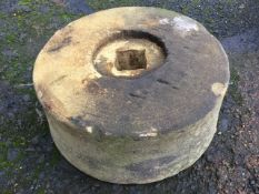 A circular sandstone grinding wheel. (13.25in x 6in)