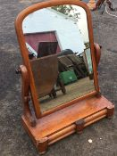 A Victorian mahogany dressing table mirror, the arched plate in cushion moulded frame on shaped