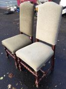 A pair of Queen Anne style upholstered hall chairs, with tall arched backs above sprung seats,