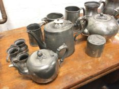 Miscellaneous pewter including tankards, teapots, a tubular pot & cover, gill measures, a