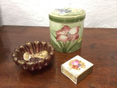 A Moorcroft tube lined floral jar & cover - lid repaired; a porcelain matchbox cover decorated