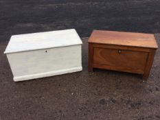 A Victorian painted pine blanket box, the interior with candlebox and small drawer, raised on