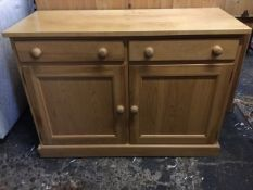 A maple & pine sideboard, with rectangular top above two knobbed frieze drawers and panelled