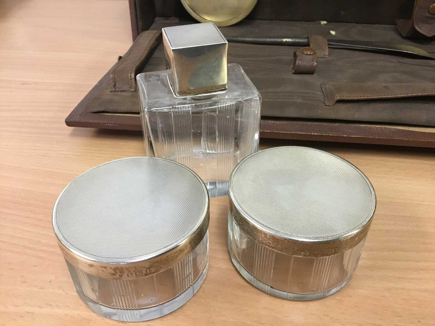 Lot 288 - Early 20th century silver mounted and glass toiletry set in original fitted case, together with anot