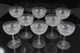 A good set of eight Edwardian cut glass champagne coupes, diamond pattern, 12cm height
