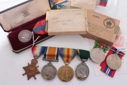 First World War and later medal group comprising 1914 - 15 Star, War and Victory, and George V Terri
