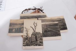 Group of five postcards showing the damage caused by the Atomic bomb at Hiroshima together with othe