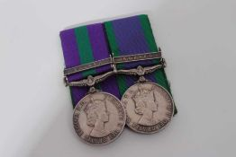 Elizabeth II medal pair comprising Pre 1962 type General Service medal with one clasp- Malaya, named