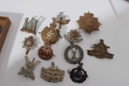 Group of cap badges and military buttons to include King's Own Malta Regiment, Inniskilling Fusilier