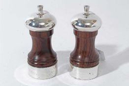 Pair of Contemporary silver mounted wooden salt and pepper mills of conventional form, (London 1992)