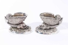 Pair of 19th century cast white metal salts in the form of a nautilus shell on the back of a dolphi