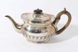 Victorian silver teapot of oval half reeded form with fruitwood knop and handle and engraved crest (
