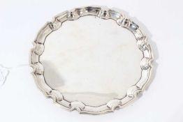 George V silver card tray of circular form with pie crust border, (Birmingham 1932), maker Cohen & C