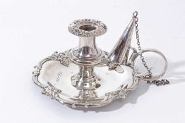 Early Victorian silver taper chamberstick of shaped circular form with foliate scroll borders, loop
