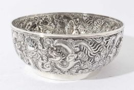 Good quality late 19th century Chinese Export silver bowl with embossed decoration depicting Dragons