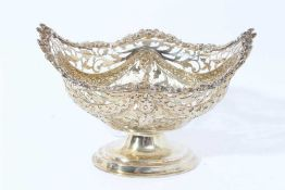 Victorian silver gilt bon bon dish of navette form, with embossed swags and pierced decoration raise