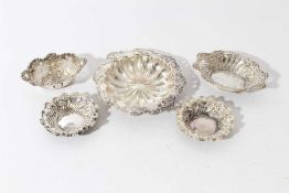 Pair of late Victorian silver embossed pin dishes (Sheffield 1895), two other pierced silver dishes