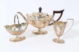 Late Victorian silver three piece bachelor's tea set of navette form, the teapot with ebony finial a