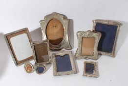 Large Edwardian silver photograph frame with reeded borders and oval photograph aperture (Birmingham