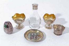 Pair of silver egg cups together with a silver egg, silver pin dish and other items