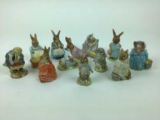 Eleven Beswick Beatrix Potter figures - Tommy Brock, Tabitha Twitchet and Miss Moppet, Mrs Flopsy Bu