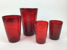 Four Whitefriars Ruby red wave ribbed vases, 25cm, 20cm, 15.5cm and 15.5cm