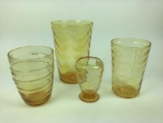Three Whitefriars Amber wave ribbed vases, 25cm, 19.5cm and 14.5cm plus a ribbon trailed vase, 18cm