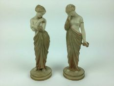 Pair of Royal Worcester Blush ivory semi clad female figures