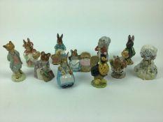 Eleven Beatrix Potter figures - Little Black Rabbit, Mrs Rabbit and Bunnies, Foxy Whiskered Gentlema