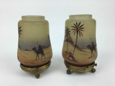 Pair of small glass nightlights decorated with Egyptian scenes on gilt metal stands