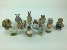 Eleven Beswick Beatrix Potter figures - Anna Maria, Hunca Munca, Flopsy Mopsy and Cottontail, Goody