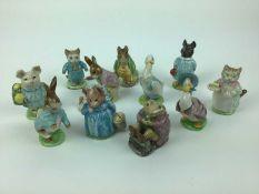 Eleven Beswick Beatrix Potter figures - Ribby, Mr Jackson, Tom Kitten, Little Pig Robinson, Mr Benja