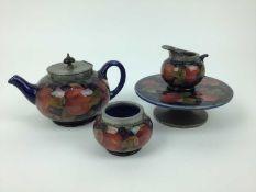Group of Moorcroft pomegranate pewter mounted tablewares - teapot, milk jug, Tarza, rosebowl