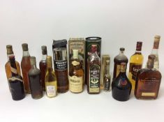 Fifteen mixed bottles to include: Glen Moray 12 Year Old Whisky, Tomintoul Glenlivet Single Highland