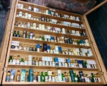 Fine collection of Scottish single malt whiskies in display cabinet, believed to represent all but t