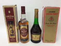 Singleton of Auchroisk 1978 single malt whiskey and bottle Cognac Chateau Paulet