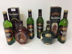 Whisky - six bottles, Glenfiddich 12 Years Old, two others in 'Clans of the Highlands' tin boxes, an