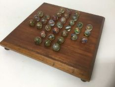 Victorian solitaire board and marbles.