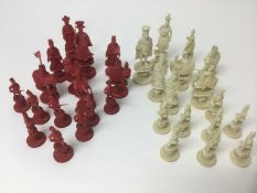 Fine 19th century carved and red stained ivory chess set